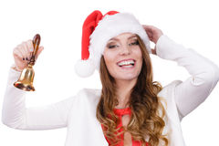 Frau in Weihnachtsmann-Hut, der eine Glocke schellt Lizenzfreies Stockbild