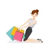 Frau, welche die Einkaufstaschen, stationierend auf Boden hält Stockbilder