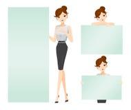 Frau, welche die leeren Zeichen eingestellt zeigt Stockfoto