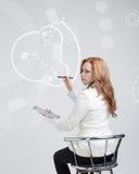 Frau zeichnet Wassermolekül Stockbild