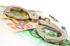 Fraud. Euro notes and handcuffs ion a white background Royalty Free Stock Images