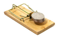 Fraud 2. Photo of a Mousetrap and Quarters Royalty Free Stock Image
