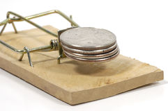 Fraud. Photo of Quarters and a Mousetrap Royalty Free Stock Photo