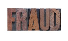 Fraud. The word 'fraud' in old ink-stained wood type Stock Photos