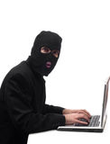 Fraud. Concept image of a businessman wearing a black balaclava stealing company information Royalty Free Stock Photos