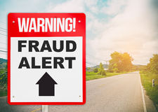 Fraud Alert ahead warning signage on the road Stock Photo