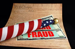 Fraud America. The constitution with American flag and financial fraud depiction Royalty Free Stock Images