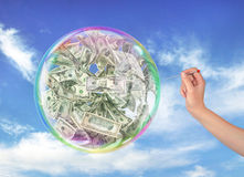 Fraud concept. The woman's hand holding the needle directed to the soap bubble full of money on a sky background. Finance risk. 3d illustration Stock Photography