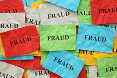 Fraud. Crumpled colorful paper notes with the word Fraud stock photography
