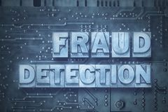 Fraud detection board. Fraud detection phrase made from metallic letterpress blocks on the pc board background stock photography