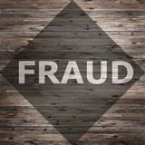 Fraud text on seasoned wood. Background royalty free stock photography