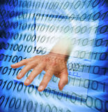 Data Information Theft Data Computer Virus Scam. A laptop computer with a hand reaching out of the computer screen and binary code Royalty Free Stock Photos