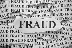 Fraud. Torn pieces of paper with the word Fraud. Black and White. Close-up royalty free stock image