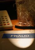 Fraud - white collar crime. Image of a fraud report on a corporate business with shredded paper in the background stock photo