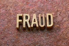 Fraud word rust. Fraud word made from metallic letters on red rusty surface royalty free stock photo