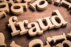 Fraud Word on Table. FRAUD word by wood alphabet scattered on the table stock photos