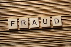 FRAUD word written on wooden cubes. Finance Concept. Money. FRAUD word written on wooden cubes. Finance concept Royalty Free Stock Image