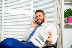 Fraudster speak mobile phone. Financial fraud crime. Man earn money on mobile conversation fraud. Blackmail and money. Extortion. Illegal money profit concept royalty free stock photo