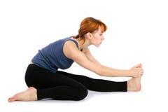 Frauen-übendes Yoga stockfoto