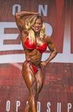 Frauen-Bodybuilder-Flex zu Toronto-Protitel Stockbilder