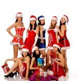 Frauen in den Weihnachtskostümen Lizenzfreie Stockfotos
