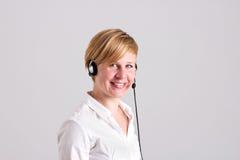 Frauen-Fahrdienstleiter mit Wechselsprechanlage stockbild
