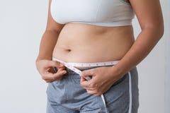 Frauen fett mit Bauchfett lizenzfreie stockfotos