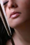 Frauen-Gesicht mit Pfeil Stockbild