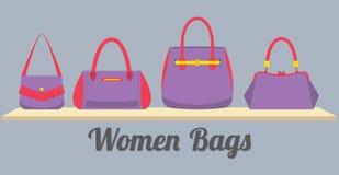 Frauen-Handtaschen-Anzeige auf Regal Stockfotos