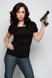 Frauen-Holding-Gewehr Stockfoto