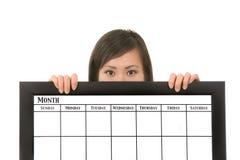 Frauen-Holding-Kalender Stockbild