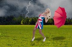 Frauen-Holding-Regenschirm Lizenzfreies Stockfoto