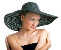 Frauen im schwarzen Hut stockfotografie
