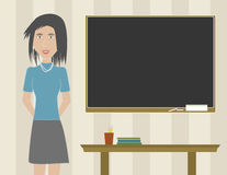 Frauen-Lehrer in einem Klassenzimmer Lizenzfreies Stockbild