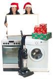 Frauen mit Weihnachtsangebot an den Haushaltsgeräten Lizenzfreie Stockfotos