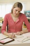 Frauen-Schreibens-Zeichen Stockbild