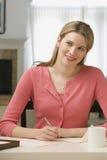 Frauen-Schreibens-Zeichen Lizenzfreies Stockbild