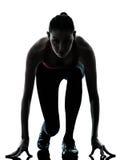 Frauen-Sprinter auf beginnendem Block Lizenzfreies Stockbild