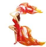 Frauen-Tanzen im roten Kleid, Stoff-Fliegen-wellenartig bewegender Tanz-Wind stockbild