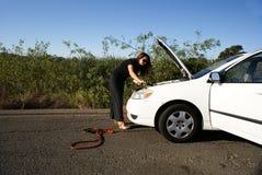 Frauen-und Batterie-Seilzüge Lizenzfreie Stockfotos