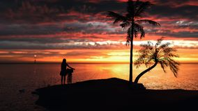 Frauen und Fahrräder, die auf dem Strand bei Sonnenuntergang stehen Stockfotos