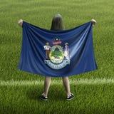 Frauen- und Maine-Flagge lizenzfreie stockbilder