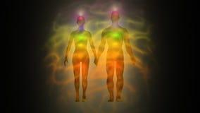 Frauen- und Mannenergiekörper, Aura, chakras lizenzfreie abbildung