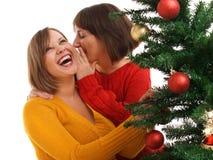Frauen und Weihnachtsbaum Stockbilder