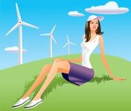 Frauen- und Windturbine im Hintergrund Lizenzfreie Stockfotos