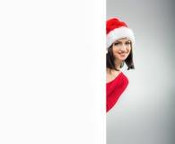Frauen-Weihnachten, Blicke heraus von hinten die Tabelle Lizenzfreies Stockfoto