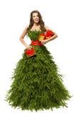 Frauen-Weihnachtsbaum-Kleid, Mode-Modell Girl Presents auf Weiß Lizenzfreie Stockfotos