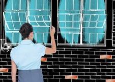 Frauenarchitekturbüro zeichnet im Negativ (hintere und weiße Linien des Schwarzen) mit Farbdetails Stockfotos