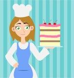 Frauenbäcker, der einen Kuchen hält Stockbild