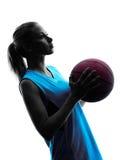 Frauenbasketball-spieler-Schattenbild lizenzfreies stockbild